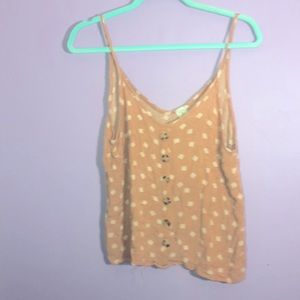 Peach colored tank top with buttons